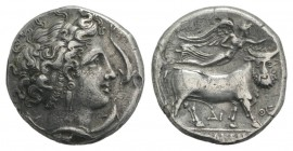 Southern Campania, Neapolis, c. 300 BC. AR Didrachm (20mm, 6.59g, 9h). Head of nymph to r., four dolphins around. R/ Man-headed bull walking r., crown...