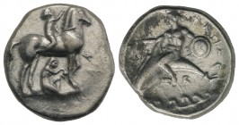 Southern Apulia, Tarentum, c. 340-335 BC. AR Nomos (22mm, 7.63g, 2h). Youth on horseback r., crowning horse; Φ to r.; below, youth removing stone from...