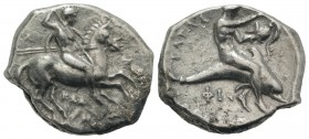 Southern Apulia, Tarentum, c. 333-331/0 BC. AR Nomos (22mm, 7.65g, 12h). Warror, preparing to throw spear and holding shield and two more spears, on h...