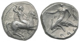 Southern Apulia, Tarentum, c. 290-281 BC. AR Nomos (19.5mm, 7.95g, 9h). Nude youth on horse standing r., placing wreath on horse's head; ΦI below. R/ ...