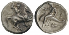 Southern Apulia, Tarentum, c. 315-302 BC. AR Nomos (21mm, 7.57g, 9h). Warrior, holding shield and two spears, preparing to cast a third, on horseback ...