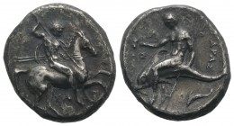Southern Apulia, Tarentum, c. 315-302 BC. AR Nomos (21mm, 7.48g, 1h). Warrior, holding shield and two spears, preparing to cast a third, on horseback ...