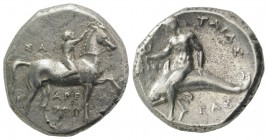 Southern Apulia, Tarentum, c. 302-280 BC. AR Nomos (21mm, 7.77g, 3h). Youth on horseback r., crowning horse; ΣA to l., APE/ΘΩN in two lines below. R/ ...