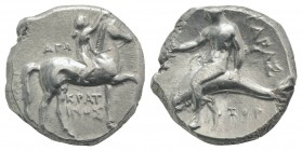 Southern Apulia, Tarentum, c. 302-280 BC. AR Nomos (19.5mm, 7.88g, 5h). Youth on horseback r., crowning horse; AΓΩ to l., KPAT/INOΣ below. R/ Phalanth...