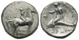 Southern Apulia, Tarentum, c. 302-280 BC. AR Nomos (21mm, 7.70g, 12h). Youth on horseback r., crowning horse with wreath; ΣA to l., ΦIΛI/APXOΣ in two ...