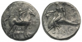 Southern Apulia, Tarentum, c. 302-280 BC. AR Nomos (21mm, 7.52g, 1h). Youth on horseback r., crowning horse with wreath; ΣA to l., ΦIΛI/APXOΣ in two l...