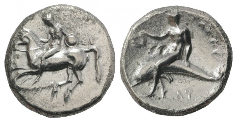 Southern Apulia, Tarentum, c. 302-280 BC. AR Nomos (22mm, 7.53g, 9h). Nude youth...