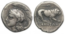 Northern Lucania, Velia, c. 280 BC. AR Didrachm (20mm, 7.35g, 3h). Helmeted head of Athena l., helmet decorated with griffin; Φ on neck guard, AP mono...