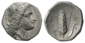Southern Lucania, Metapontion, c. 325-275 BC. AR Stater (20mm, 6.74g, 1h). Head of Demeter r., wearing grain-ear wreath and earring. R/ Barley ear, le...