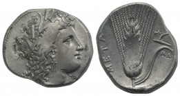 Southern Lucania, Metapontion, c. 325-275 BC. AR Stater (23mm, 7.82g, 3h). Head of Demeter r., wearing grain-ear wreath and earring. R/ Barley ear, le...