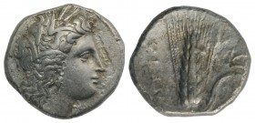 Southern Lucania, Metapontion, c. 325-275 BC. AR Stater (22mm, 7.38g, 6h). Head of Demeter r., wearing grain-ear wreath and earring. R/ Barley ear, le...