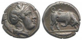 Southern Lucania, Thourioi, c. 400-350 BC. AR Stater (20mm, 7.82g, 12h). Helmeted head of Athena r., helmet decorated with Skylla pointing and holding...