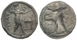 Bruttium, Kaulonia, c. 525-500 BC. AR Stater (29mm, 7.69g, 12h). Apollo advancing r., holding branch; small daimon running r. on Apollo's l. arm; to r...