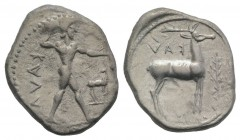 Bruttium, Kaulonia, c. 475-425 BC. AR Stater (24mm, 7.85g, 1h). Nude Apollo walking r., holding branch, holding small running daimon on outstretched a...