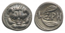 Bruttium, Rhegion, c. 415/0-387 BC. AR Litra (9mm, 0.78g, 9h). Facing lion's head. R/ PH within olive sprig. HNItaly 2499; SNG ANS 670-4. Toned, EF