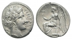 Bruttium, Terina, c. 300 BC. AR Drachm (14mm, 2.06g, 7h). Head of nymph r.; triskeles behind. R/ Nike seated l. on plinth, holding kerykeion. Holloway...