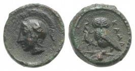 Sicily, Kamarina, c. 410-405 BC. Æ Onkia (10mm, 1.19g, 12h). Helmeted head of Athena l. R/ Owl standing l., grasping lizard; pellet in exergue. CNS II...