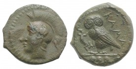 Sicily, Kamarina, c. 420-410 BC. Æ Tetras (14mm, 2.90g, 7h). Head of Athena l., wearing crested Corinthian helmet; olive-spray before. R/ Owl standing...