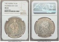 Salzburg. Johann Ernst Taler 1702 MS63 NGC, KM254, Dav-1234. A choice offering with fully struck features and glasslike fields which exhibit a delicat...