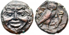 Sicily, Kamarina. Æ Onkia (1.44 g), ca. 420-405 BC. Gorgoneion facing. Reverse: KAMA, owl standing right, head facing, grasping lizard; in exerg...