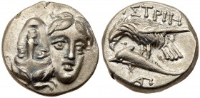 Moesia, Istros. Silver Drachm (5.51 g), 4th century BC. Facing male heads, the left inverted. Reverse: IΣTPIH, sea-eagle left, grasping dolphin ...