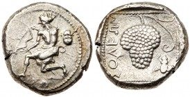 Cilicia, Soloi. Silver Stater (10.62 g), ca. 440-410 BC. Amazon kneeling left, holding bow; to right, head of satyr facing. Reverse: Grape bunch on vi...
