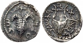 Judaea, Bar Kokhba Revolt. Silver Zuz (3.21 g), 132-135 CE. Undated, attributed to year 3 (134/5 CE). 'Simon' (Paleo-Hebrew), bunch of grapes with lea...