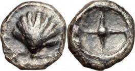 Greek Italy. Southern Apulia, Tarentum. AR Litra, 480-470 BC. D/ Shell. R/ Wheel with four spokes. HN Italy 835. AR. g. 0.71 mm. 8.00 Toned. Good VF.