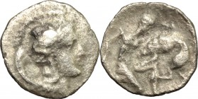 Greek Italy. Southern Apulia, Tarentum. AR Diobol, 380-325 BC. D/ Head of Athena right, helmeted. R/ Heracles kneeling right and fighting with lion. H...