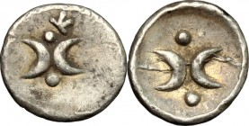 Greek Italy. Southern Apulia, Tarentum. AR Hemiobol, 325-280 BC. D/ Two crescents back to back; above and below, pellet. R/ Two crescents back to back...