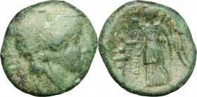 Greek Italy. Bruttium, Hipponium. AE, c. 296 BC. D/ Head of Athena right, helmeted. R/ Nike standing left; holding wreath and scepter; to right, troph...