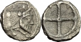 Sicily. Gela. AR Obol, before 405 BC. D/ Forepart of man-headed bull right. R/ Wheel with four spokes. SNG Cop. 259. AR. g. 0.59 mm. 9.00 Toned. VF.
