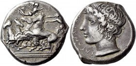 Catana. Tetradrachm signed by Heracleidas circa 405, AR 17.11 g. Fast quadriga driven l. by charioteer, holding reins in both hands; above, Nike flyin...