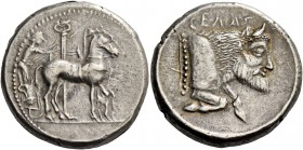 Gela. Tetradrachm circa 465-460, AR 17.18 g. Slow quadriga driven r. by charioteer holding reins and kentron; in the foreground, column. Rev. CΕΛΑΣ Fo...