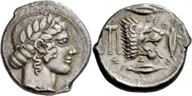 Leontini. Tetradrachm circa 460-450, AR 17.24 g. Laureate head of Apollo r., hair rolled behind neck. Rev. LEO – N – T – IN – ON Lion's head r., with ...