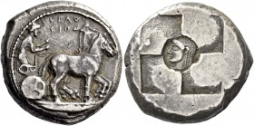 Syracuse. Tetradrachm circa 510-490, AR 17.22 g. SVRAKO / ΣION Slow quadriga driven r. by clean-shaven charioteer, wearing long chiton and holding rei...