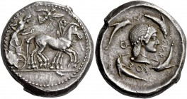 Syracuse. Tetradrachm circa 480-475, AR 17.49 g. Slow quadriga driven r. by bearded charioteer, wearing chiton and holding kentron and reins; above, N...