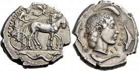 Syracuse. Tetradrachm circa 460-440, AR 17.36 g. Slow quadriga driven r. by charioteer, holding kentron and reins; above, Nike flying r. to crown hors...