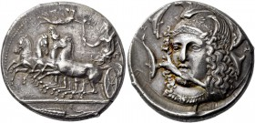 Syracuse. Tetradrachm, signed by Eukleidas circa 405-400, AR 17.27 g. Fast quadriga driven l. by female charioteer, holding reins in l. hand and raisi...