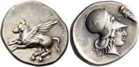 Epirus, Ambracia. Stater circa 404-360, AR 8.48 g. Pegasus flying l.; on hindquarter, A. Rev. Head of Athena r., wearing Corinthian helmet decorated w...