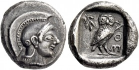 Attica, Athens. Drachm circa 500-490, AR 4.23 g. Helmeted head of Athena r., wearing earring and necklace. Rev. AΘE Owl standing r., head facing; in l...