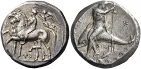 Calabria, Tarentum. Nomos circa 340-335, AR 7.84 g. Naked ephebos, crowned by Nike flying l., riding trotting horse l. and leading another beside it i...