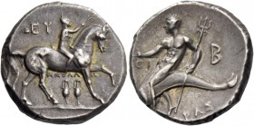 Calabria, Tarentum. Nomos circa 280-272, AR 6.46 g. Nude youth on horseback r., crowning horse that raises l. foreleg; above, EY and below, ΑΠΟΛΛΩ and...
