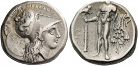Lucania, Heraclea. Nomos circa 281-278, AR 7.83 g. Helmeted head of Athena r., bowl decorated with Scylla hurling stone; behind neck-guard, E. Rev. He...