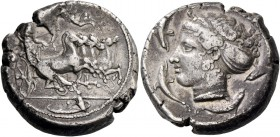 Syracuse. Tetradrachm signed by Euainetos circa 413-405, AR 17.18 g. Fast quadriga driven r. by charioteer holding reins and kentron. Above, Nike flyi...