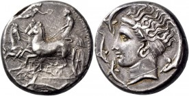 Syracuse. Tetradrachm in the style of Eukleidas, circa 405-400, AR 17.28 g. Fast quadriga driven l. by charioteer, holding kentron in r. hand and rein...