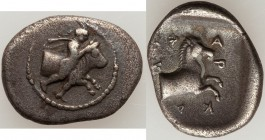 THESSALY. Pharcadon. Ca. 440-400 BC. AR hemidrachm (17mm, 2.71 gm, 11h). VF. Thessalus, nude but for petasus and cloak tied at neck, holding band arou...