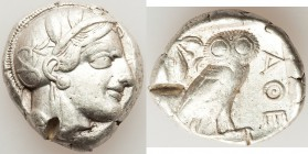 ATTICA. Athens. Ca. 440-404 BC. AR tetradrachm (25mm, 17.17 gm, 9h). VF, test cut. Mid-mass coinage issue. Head of Athena right, wearing crested Attic...