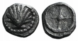 Southern Apulia, Tarentum, c. 480-470 BC. AR Litra (8mm, 0.72g). Cockle shell. R/ Wheel of four spokes. Vlasto 1108-11; HNItaly 835. Scarce, near VF
