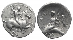 Southern Apulia, Tarentum, c. 290-281 BC. AR Nomos (19mm, 7.86g, 7h). Warrior, holding shield and two spears, preparing to cast a third, on horseback ...